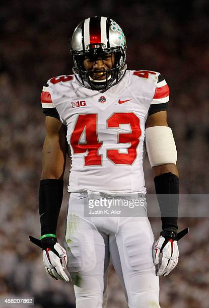 Darron Lee of the Ohio State Buckeyes looks on during the game against the Penn State Nittany Lions on October 25 2014 at Beaver Stadium in State...