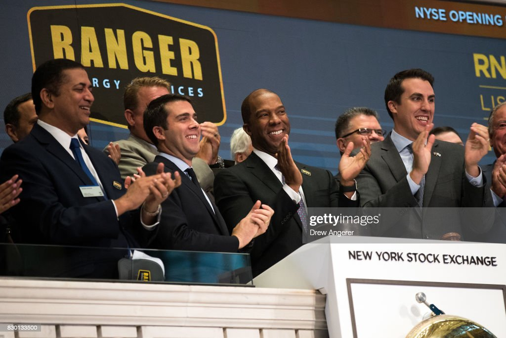 Darron M. Anderson (C), president and chief executive officer of Ranger Energy Services, applauds after ringing the opening bell to celebrate his company's initial public offering (IPO) at the New York Stock Exchange (NYSE), August 11, 2017 in New York City.