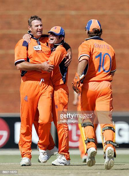 Darron Reekers of the Netherlands is congratulated by Peter Borren and Jeroen Smits during the ICC Mens Cricket World Cup qualifier match between...