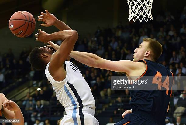 Darrun Hilliard II of the Villanova Wildcats is fouled by Ben Oberfeld of the Bucknell Bison at The Pavilion on November 20 2014 in Villanova...