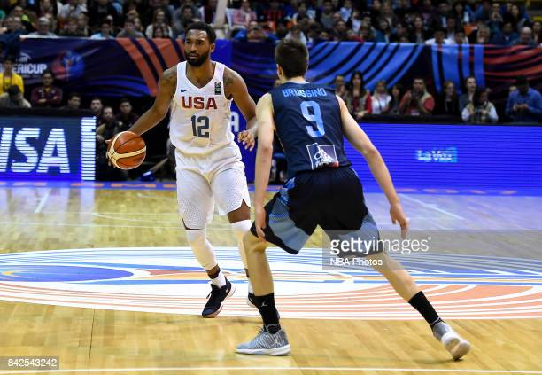 Darrun Hilliard II of United States challenges Nicolas Brussino of Argentina during the FIBA Americup final match between US and Argentina at Orfeo...