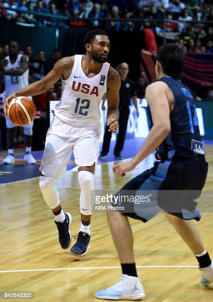 Darrun Hilliard II of United States fights for ball with Gabriel Deck of Argentina during the FIBA Americup final match between US and Argentina at...