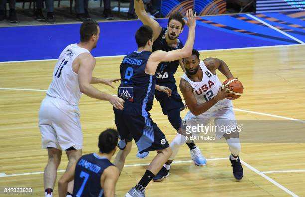 Darrun Hilliard II of United States fights for the ball with Nicolas Brussino and Marcos Delia of Argentina during the FIBA Americup final match...