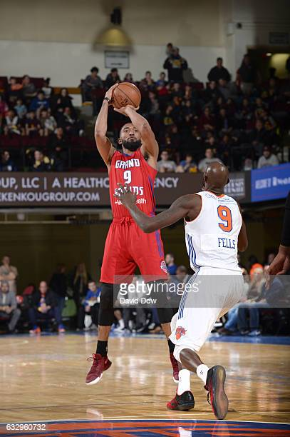 Darrun Hilliard of the Grand Rapids Drive shoots the basketball against Courtney Fells of the Westchester Knicks at the Westchester County Center on...