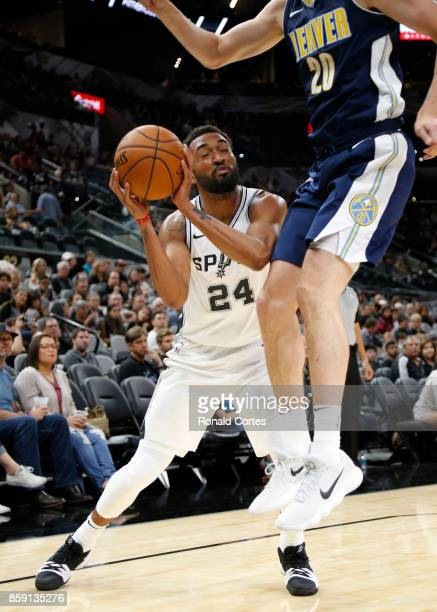 Darrun Hilliard of the San Antonio Spurs is fouled by Tyler Lydon of the Denver Nuggets at ATT Center on October 8 2017 in San Antonio Texas NOTE TO...