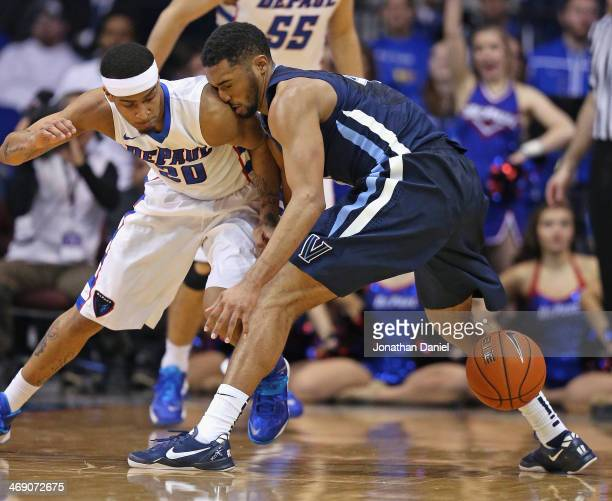 Darrun Hilliard of the Villanova Wildcats looses control of the ball after colliding with Brandon Young of the DePaul Blue Demons at the Allstate...