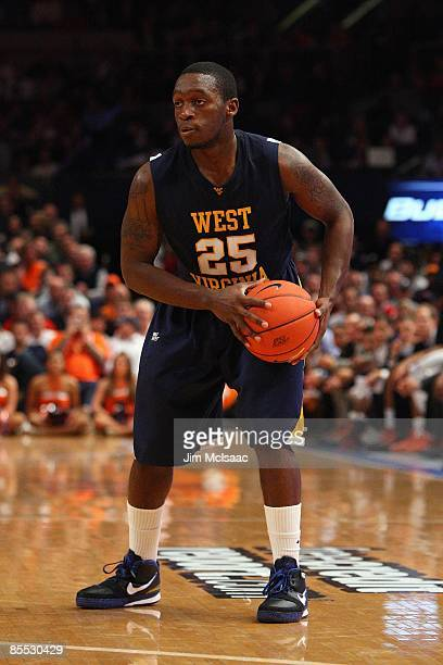 Darryl Bryant of the West Virginia Mountaineers holds the ball against the Syracuse Orange during the semifinal round of the Big East Tournament at...