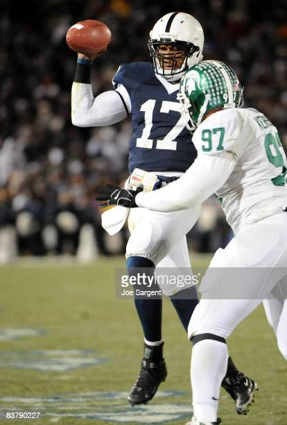 Darryl Clark of the Penn State Nittany Lions scrambles in front of Justin Kershaw of the Michigan State Spartans on November 22 2008 at Beaver...