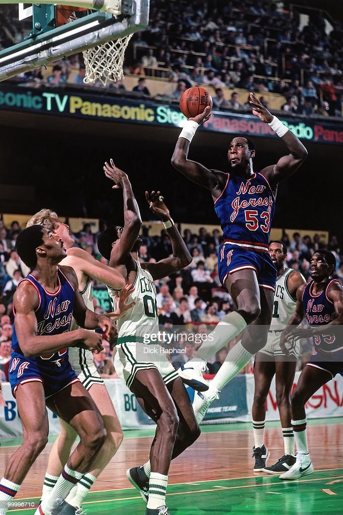 Darryl Dawkins #53 of the New Jersey Nets goes up for a shot against Robert Parish #00 of the Boston Celtics during a game played in 1983 at the Boston Garden in Boston, Massachusetts.