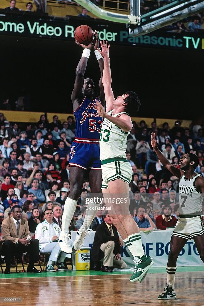 Darryl Dawkins #53 of the New Jersey Nets shoots a jumper against Joe Kleine #53 of the Boston Celtics during a game played in 1983 at the Boston Garden in Boston, Massachusetts.