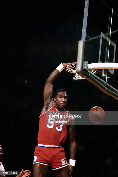 Darryl Dawkins of the Philadelphia 76ers dunks during a 1975 NBA game against the New York Knicks at Madison Square Garden in New York New York NOTE...