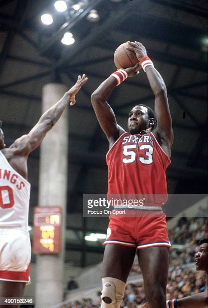 Darryl Dawkins of the Philadelphia 76ers shoots over Harvey Catchings of the New Jersey Nets during an NBA basketball game circa 1978 at the Rutgers...
