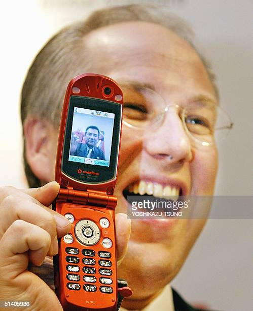 Darryl Green president of Japanese mobile communication operator JPhone owned by Britain's Vodafone unveils a new 3G video phone handset produced by...