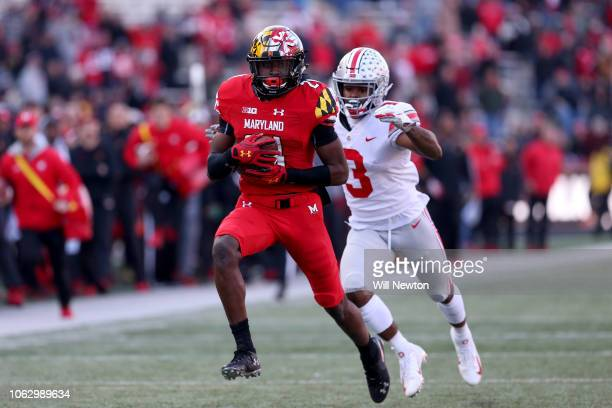 Darryl Jones of the Maryland Terrapins runs past Damon Arnette of the Ohio State Buckeyes during the second half at Capital One Field on November 17...