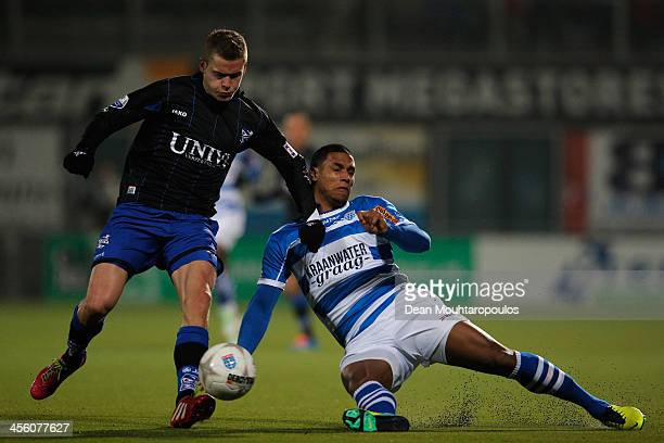 Darryl Lachman of Zwolle and Alfred Finnbogason of Heerenveen battle for the ball during the Eredivisie match between PEC Zwolle and SC Heerenveen...