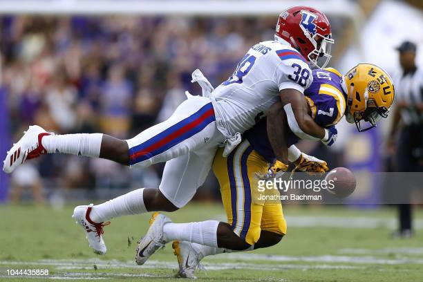 Darryl Lewis of the Louisiana Tech Bulldogs breaks up a pass intended for Jonathan Giles of the LSU Tigers during a game at Tiger Stadium on...