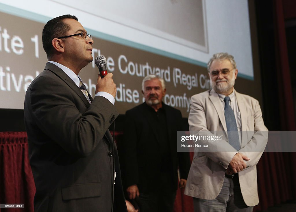 Darryl MacDonald, Palm Springs Film Festival director (C), looks on as Assemblymember V. Manual Perez (L) honors Latin American filmmaker Ivan Trujillo (R) at a proclamation event where Trujillo was honored for his film accomplishments at the 24th Annual Palm Springs International Film Festival on January 11, 2013 in Palm Springs, California.