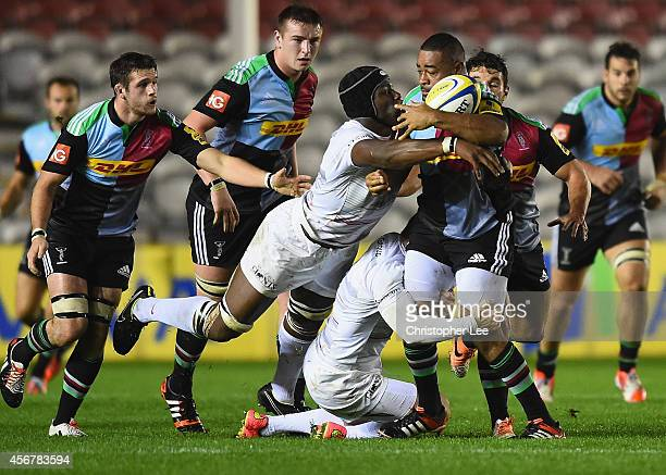 Darryl Marfo of Harlequins is tackled by Ben Spencer and Maro Itoje of Saracens during the Premiership A League match between Harlequins A and...