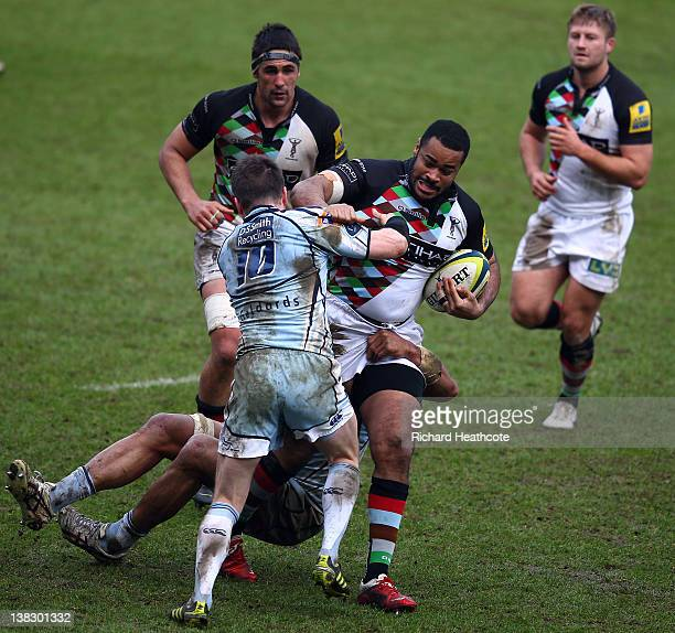 Darryl Marfo of Quins is tackled by Ceri Sweeney of Cardiff during the LV= Cup match between Cardiff Blues and Harlequins at the Cardiff City Stadium...
