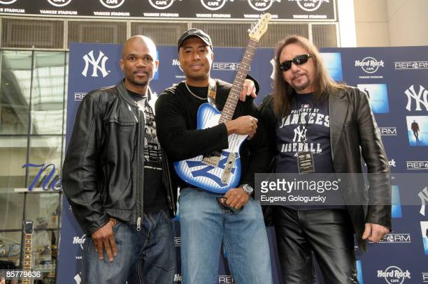 Darryl McDaniels, Bernie Williams and Ace Frehley attend the opening of the Hard Rock Cafe Yankee Stadium on April 2, 2009 in Bronx, New York.