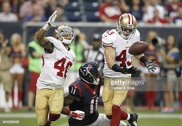 Darryl Morris and Craig Dahl of the San Francisco 49ers breaks up a pass intended for DeVier Posey of the Houston Texans in the first quarter in a...