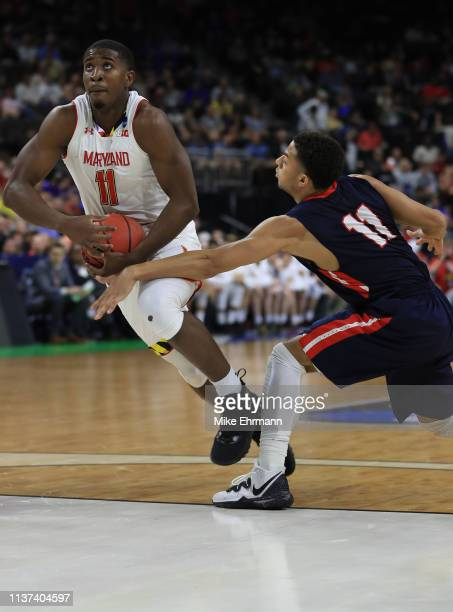 Darryl Morsell of the Maryland Terrapins dribbles the ball against Kevin McClain of the Belmont Bruins in the first half during the first round of...