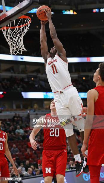 Darryl Morsell of the Maryland Terrapins dunks over Tanner Borchardt of the Nebraska Cornhuskers at the United Center on March 14 2019 in Chicago...