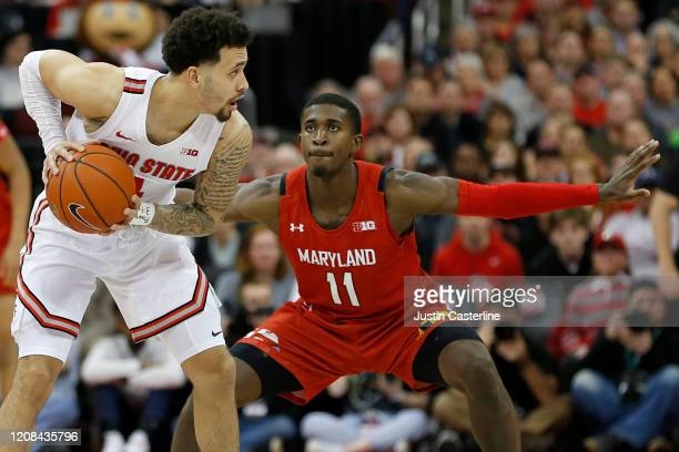 Darryl Morsell of the Maryland Terrapins guards Duane Washington Jr. #4 of the Ohio State Buckeyes at Value City Arena on February 23, 2020 in...