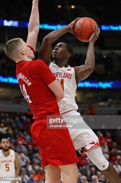 Darryl Morsell of the Maryland Terrapins shoots against Thorir Thorbjarnarson of the Nebraska Cornhuskers at the United Center on March 14 2019 in...