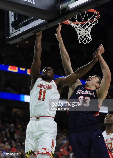 Darryl Morsell of the Maryland Terrapins takes a shot against Nick Muszynski of the Belmont Bruins in the first half during the first round of the...