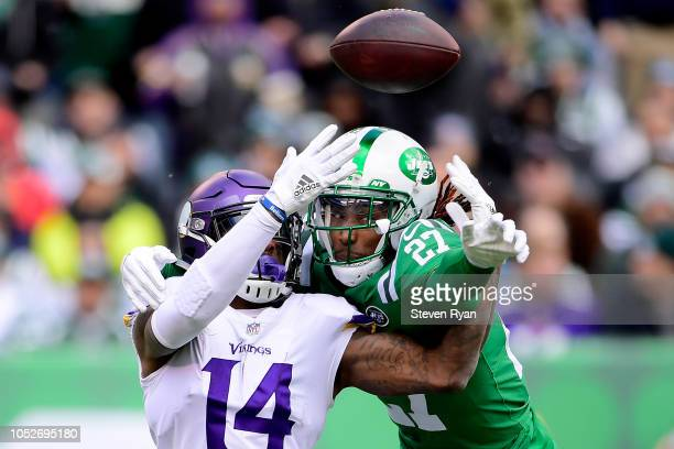 Darryl Roberts of the New York Jets breaks up a pass intended for Stefon Diggs of the Minnesota Vikings during the first quarter at MetLife Stadium...