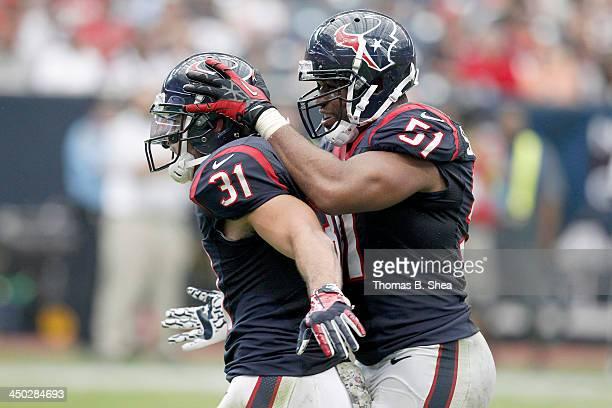 Darryl Sharpton celebrates Shiloh Keo of the Houston Texans defensive play against Rashad Jennings of the Oakland Raiders on November 17 2013 at...