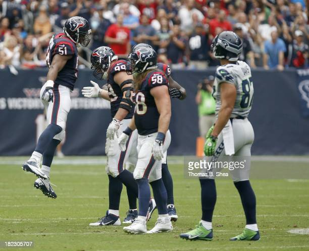 Darryl Sharpton of the Houston Texans celebrates JJ Watt of the Houston Texans sack on Russell Wilson of the Seattle Seahawks on September 29 2013 at...