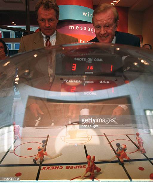 Darryl Sittler and Ted Rogers team up in a table hockey game for the Child Find charity They were also there to open an new store and get free...