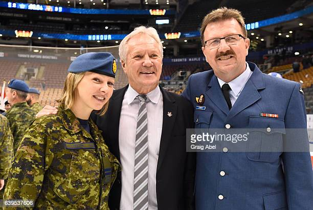 Darryl Sittler former Toronto Maple Leafs great stands for picture with members of Canada's military during the Leafs 11th annual Armed Forces...