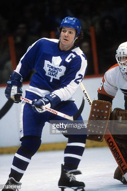 Darryl Sittler of the Toronto Maple Leafs looks to screen the goaltender during an NHL game against the Philadelphia Flyers on March 15 1981 at the...