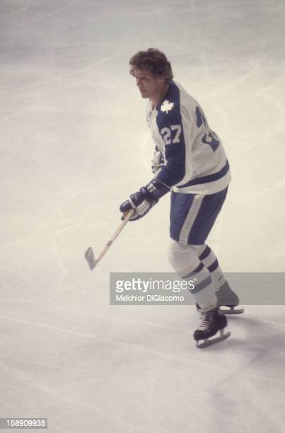 Darryl Sittler of the Toronto Maple Leafs passes the puck during an NHL game circa 1973 at the Maple Leaf Gardens in Toronto Ontario Canada
