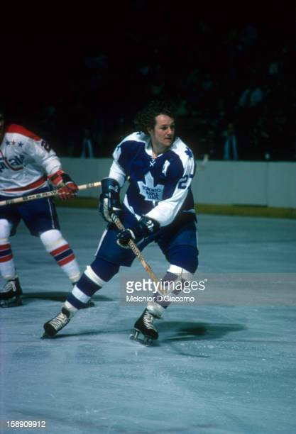 Darryl Sittler of the Toronto Maple Leafs skates on the ice during an NHL game against the Washington Capitals in 1976 at the Capital Centre in...