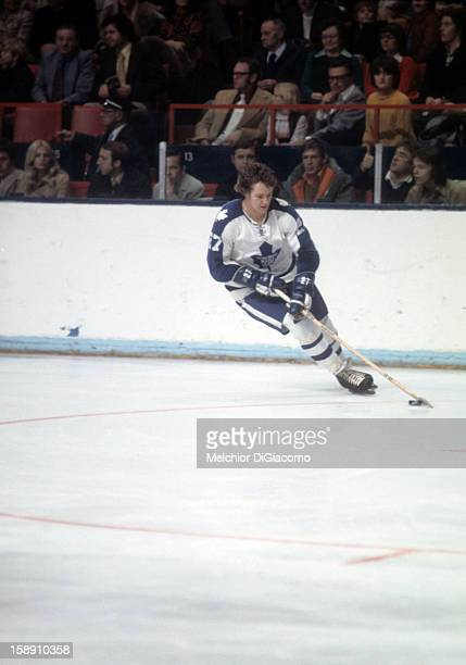 Darryl Sittler of the Toronto Maple Leafs skates with the puck during an NHL game circa 1973 at the Maple Leaf Gardens in Toronto Ontario Canada