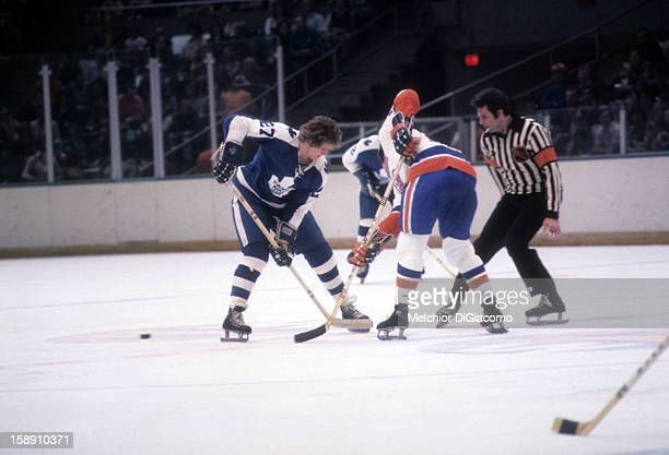 Darryl Sittler of the Toronto Maple Leafs wins the faceoff during an NHL game against the New York Islanders circa 1973 at the Nassau Coliseum in...