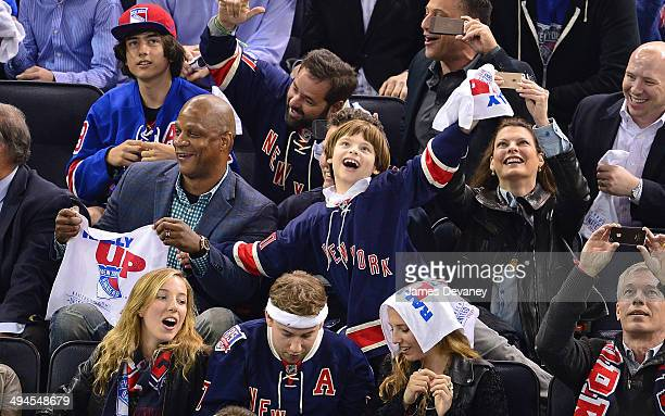 Darryl Strawberry Augustin James Evangelista and Linda Evangelista attend Montreal Canadiens vs New York Rangers playoff game at Madison Square...