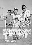 Darryl Strawberry of the Mets with wife Lisa and children