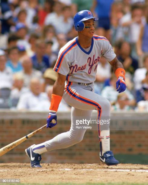 Darryl Strawberry of the New York Mets bats during an MLB game against the Chicago Cubs at Wrigley Field in Chicago Illinois during the 1989 season