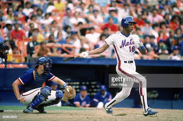 Darryl Strawberry of the New York Mets follows through on a swing during a 1984 season game against the Chicago Cubs at Shea Stadium in Flushing New...