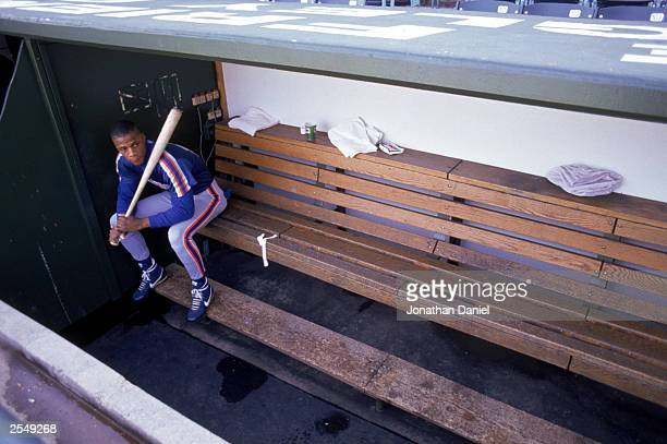 Darryl Strawberry of the New York Mets sits in the dugout during a game in the 1990 season Photo by Jonathan Daniel/Getty Images