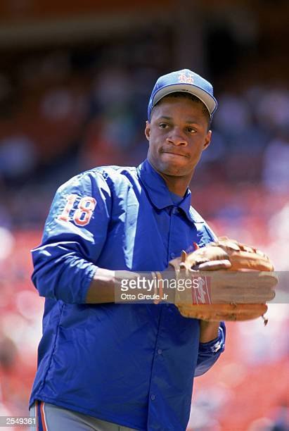 Darryl Strawberry of the New York Mets throws the ball during practice before a game in the 1989 season Photo by Otto Greule Jr/Getty Images