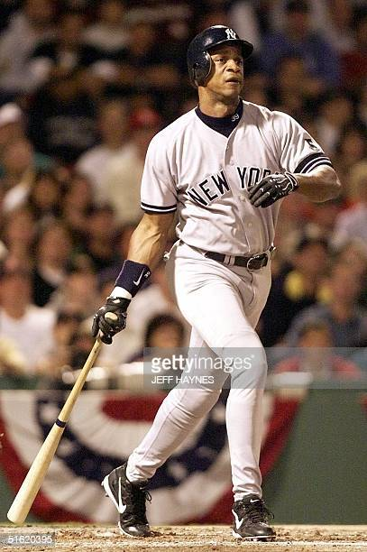 Darryl Strawberry of the New York Yankees follows through on his second inning solo home run against the Boston Red Sox 17 October in game four of...