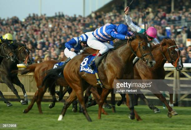 Darryll Holland and Milk It Mick get the better of the Richard Hughes ridden Three Valleys to land The Darley Dewhurst Stakes race run at Newmarket...