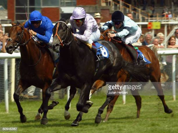 Darryll Holland and Perfect Choice lead the Godolphin trained Financial Times ridden by Frankie Dettori and the Richard Hughes ridden Councellor home...