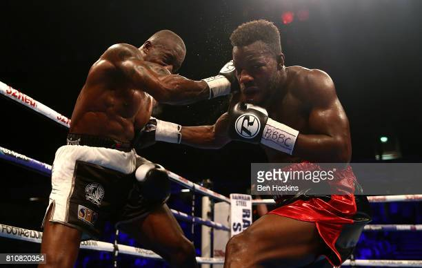 Darryll Williams of Great Britain and Jahmaine Smyle of Great Britain exchange blows during their English SuperMiddleweight Championship bout at...